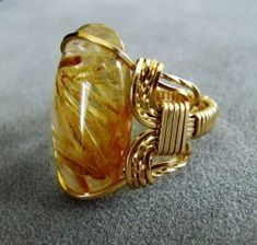 "Gold rutilated quartz ring by Dale ""Cougar"" Armstrong"