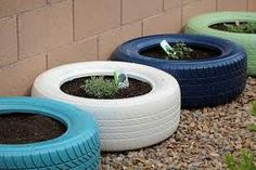 old tires + paint = planter As red neck as this is... It is an easy way to create a little raised bed.