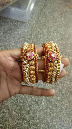 Antique Pearl Ruby Bangle gold antique bangle studded with rubies and embellished with pearl clusters. For inquiries please contact the seller below. Seller Name : Rohit Jewellers Contact : 098497 95735 Related PostsGold Oxidized Bangles With PearlsBig The Bangles, Ruby Bangles, Bracelets Design, Gold Bangles Design, Jewelry Design, Schmuck Design, Jewelery, Gold Jewellery, Ruby Jewelry