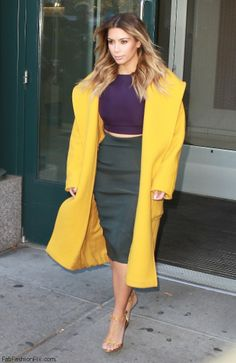 Kim Kardashian style. Love the yellow coat.