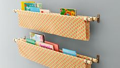 Organize a wall-mounted library out of curtain hardware, dowels, and your favorite fabric in just a few hours.