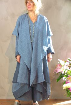 New Edy Jacket in lightweight linen £295, over Emily Shift Dress £265, over Attius Trousers £215, with handwoven 'Khadi' Shawl, £72. (Various blues).