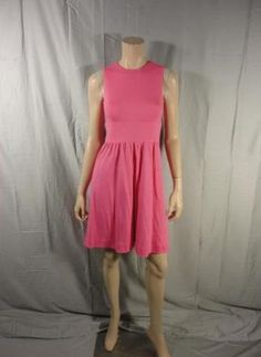 Desperate Housewives        This unique item is from the television show Desperate Housewives.    This is Lynette Scavo's screen worn wardrobe item.        Season:  Six    Episode Title:  611         Items: Sleeveless, Knee-Length Dress      Wardrobe Details          DRESS   Brand: Dorian May      Size: 2      Material: 100% Wool      Color: Pink      Condition: Good Condition      Original Retail Price: Not Available