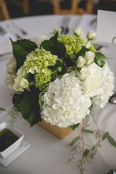 Green and white hydrangea with seeded eucalyptus and spray rose filler. Flowers by Regalo Design.