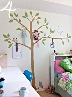 It's not just a painted tree - it's the hooks to add adornment. Charming and easily done!