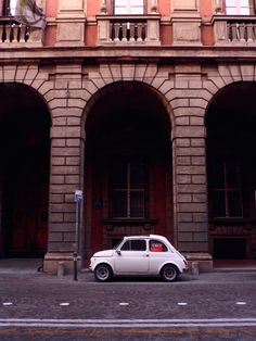 Small car, big city. Classic Fiat 500 for sale in Bologna, Italy