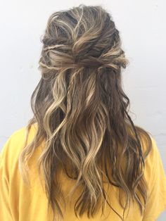 Boho hair prom updo with braids and twists and messy waves half up half down updo loose messy boho chic done at a hair salon in downtown Medford Oregon called Cielo Salon