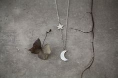 Little crescent half moon and star suspended on a delicate Hayseed chain*.Fully Hallmarked.MEASURES:Moon: 1.7cm x 1.2cmStar: 1.2 x 1.2cmChain length: 46cm