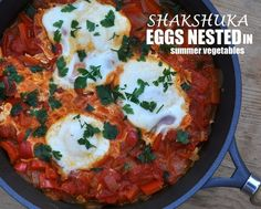 Shakshuka (Eggs Nested in Summer Vegetables), traditional North African-Israeli breakfast dish, peppers & tomatoes slowly simmered, 'nested' to cook whole eggs. WW2 or 4.