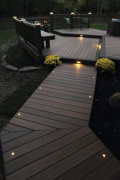 Home Remodel Exterior This more modern outdoor lighting makes a wood finish patio in a shabby chic garden look elegant.Home Remodel Exterior This more modern outdoor lighting makes a wood finish patio in a shabby chic garden look elegant. Outside House Decor, Timbertech Decking, Trex Decking, Patio Deck Designs, Deck Patio, Back Yard Design, Diy Deck, Decking Area, Walkway Designs