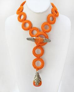 Om O Necklace- the purchase of this Om O necklace affords 124 meals to children in Nepal www.unattihandicrafts.com