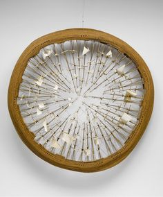 "Tim Hawkinson, H.M.S.O.,1995. Fabric, string, and wood, 90"" (228.6 cm) diameter x 10"" (25.4 cm)"