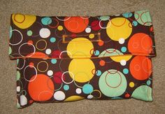 possibly make something like this...  (fold out into a changing pad on the go?)  (similar to my ceramic tool pouch)