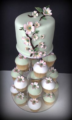 Maybe an idea would be a super pretty tiny cake for everyone to see and then normal cake to eat? Wedding Series by Small Things Iced: Dogwood Wedding Tower