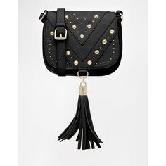 ASOS Studded Saddle Bag with Tassel ($38) ❤ liked on Polyvore featuring bags, handbags, shoulder bags, black, flap handbags, studded purse, black studded handbag, tassel handbag and studded shoulder bag