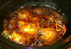 """Chicken Adobo in the Slow Cooker Ingredients: ½ cup balsamic or apple cider vinegar ½ cup regular soy sauce 1 tsp. ground or fresh grated ginger 4-6 garlic cloves, peeled 1 red onion 2 bay leaves 1 tbsp. black pepper 1 tsp. brown sugar 1 large package of chicken thighs, or thighs/drumsticks mix (roughly 10-12, or until your slow cooker screams """"No More""""!) 1/2 bunch chopped green onions or chives, for serving"""