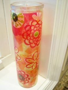 Decoupaged Spring candle done with Modge Podge & wrapping tissue paper