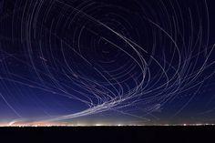 1x.com is the world's biggest curated photo gallery online. Each photo is selected by professional curators. Startrails and Planetrails over the Tokyo Bay by Yasushi Okumura
