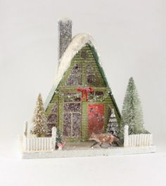 """A retro green and red Christmas Putz A-Frame House with Fox. - 13"""" H x 13"""" W x 7"""" D. - Pressed paper putz house with batting and mica glitter snow. - Optional: Add a C7 Light (sold separately) to illu"""