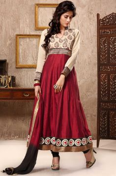 If versatility is on your mind then go for this Banarasi weaved maroon Anarkali salwar suit which is made of cotton silk. It's enriched with thread embroidery.