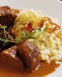 Spaetzle with Gruyère and Caramelized Onions- a German inspired dish to make during Oktoberfest festivities! Would make a fabulous pot roast side dish.