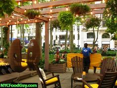 Southwest Porch at Bryant Park - Café / restaurant garden setting with cozy pergola outdoor seating!