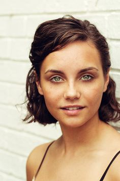 Loving spirit, short bown hair, green eyes and the perfect natural skin. I can't tell if she has freckles.