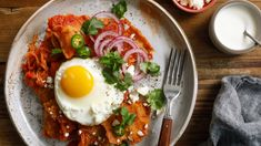 Chilaquiles, a traditional Mexican dish made with fried tortillas simmered in red or green salsa, has become a popular breakfast item because it begs to be topped with a couple of fried eggs This cheater's version is made with a fresh tomato (or tomatillo) salsa that doesn't require a blender, and tortilla chips or broken tostadas instead of fried tortillas The perfect texture here is softened but not soggy; you want to make sure the chips are tossed evenly with the sauce, but not so much…