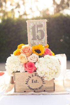 milk-crate-turned-into-wedding-centerpiece-table-number. a way to tie in the wine bottle/cork thing? Meg, this would look beautiful with your colors Centerpiece Table, Wedding Table Centerpieces, Wedding Decorations, Flower Centerpieces, Summer Wedding, Our Wedding, Dream Wedding, Church Wedding, Wedding Reception