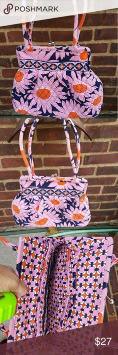Fab Vera Bradley kisslock bag Bad person really wonderful condition. 4 inches across the bottom with a pocket in the front and many interior compartments. 11 inches in lengrh, 14 inches at the widest and approximate 9.5 inch drop. Great bag. Vera Bradley Bags Shoulder Bags