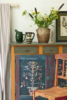From Colour Recipes by Annie Sl-an, published by Cico books, a side board painted in Barcelona Orange and Aubusson with Olive and Burdundy mixed with Emperors Silk. Paper cut outs on the doors.