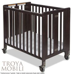 Foundations HideAway Folding Compact Crib - Antique Cherry - The term convenient doesn't cut it. The Foundations HideAway Folding Compact Crib - Antique Cherry is highly functional, incredibly versatile, and surprisingly. Nursery Furniture, Kids Furniture, Preschool Furniture, Cherry Furniture, House Furniture, Wood Crib, Compact, Portable Crib, Thing 1
