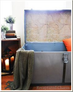 a metal trunk redo.  I love the idea of using old vintage maps to clean up the inside of a trunk or suitcase.