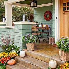 Give your front porch a sense of warmth and comfort by placing a piece or two of weather-resistant furniture near the entry. A bistro set is an easy addition for any porch size -- and a perfect spot to relax outdoors with a cup of coffee. A welcoming wreath overhead rounds out front porch decor.