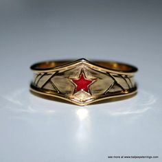 Custom Wonder Woman Inspired Tiara Ring with Red enameled star by Batjeepster on Etsy https://www.etsy.com/listing/220154461/custom-wonder-woman-inspired-tiara-ring
