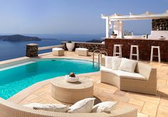 @Tholos Resort Hotel Santorini - our pool and the pool bar #destination #greece #santorini