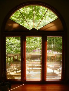 Moveable arched window treatments for half quarter for Motorized arch window treatments