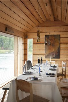 Summer House by JOARC Architects. Located in Archipelago, Southern Finland House Cladding, Getaway Cabins, Cottage Living Rooms, Weekend House, Dining Room Lighting, Cottage Design, Cabin Homes, Interior Design Studio, Dining Room Design