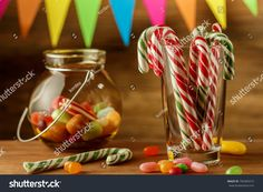 Colored candy in a jar. Sweets for Christmas. Greeting card. Candy canes. Marmalade.