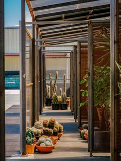 Sliding mesh walls are designed to open up the compartments of this greenhouse for cactuses and large plants, which architecture studio Part Office has added to an industrial-style office building in Santa Monica.