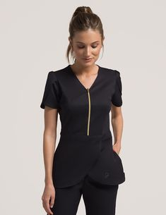 Tulip Top in Black - Medical Scrubs Tulip Top in Black is a contemporary addition to women& medical scrub outfits. Shop Jaanuu for scrubs, lab coats and other medical apparel. Dental Uniforms, Work Uniforms, Dental Scrubs, Medical Scrubs, Schönheitssalon Design, Spa Uniform, Cute Scrubs Uniform, Stylish Scrubs, Professional Outfits