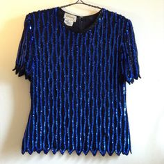 "✨VINTAGE✨ Sequin Top 80s/90s glitz sparkle 💲⬇️‼️ GORGEOUS vintage sequin top - perfect for the party season! Black beads, bright blue sequins, 100% semi-sheer silk, polyester lining, long back zipper. Awesome jagged hem detailing, slight flare from waist - in fantastic condition with only some loose stitches on armpit seam (see closeup) & few missing collar beads. Marked Petite Large, but could fit a medium with nice draping. Measurements flat across: 21"" armpit to pit, 17.25"" waist, 21""…"