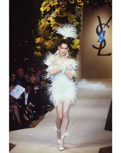 Laetitia Casta in feathers for Yves Saint Laurent, 2000