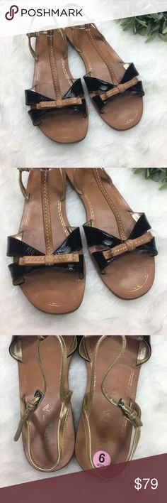 Prada Black & Brown Flats Sandals Size 9 Good condition. Prada Bow Black, brown and Gold color sandals. Leather Bow Flats, super chic and cute!  Size 9 Prada Shoes Sandals
