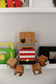 cute little pirate.  looks easy enough to DIY - maybe a robot like this to hang in the flower center piece for the shower