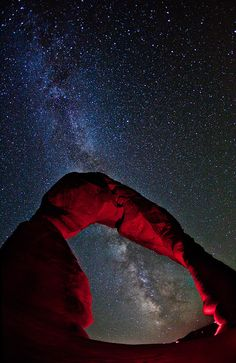 (Moab, Utah) The pride of Arches National Park; Delicate Arch, stretches towards the Milky Way.