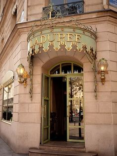 Facade original patisserie in Paris.  Art Deco style features its grandeur and sophistication.