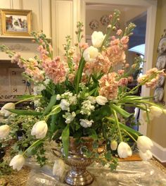 Arrangement of stock, tulips and ivy in a vintage champagne bucket I created for a fundraiser party.