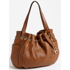 SALE Michael Kors Jet Set Chain Tote Made of a beautiful genuine tan leather. Gently worn with some pen marks inside & outside the purse, snap tab hardware also has some signs of usage (please refer to 4th pic) but in otherwise great condition. Purchased from Macy's. Will come with tags and dust bag. I have described the item to the best of my ability, but I'd be more than happy to answer any questions. No trades, I'm sorry. Thank you!  MICHAEL Michael Kors Bags Totes