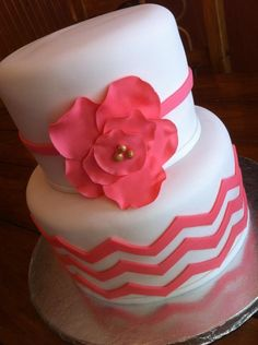 Strawberry lemonade cake done in coral chevron with fantasy flower